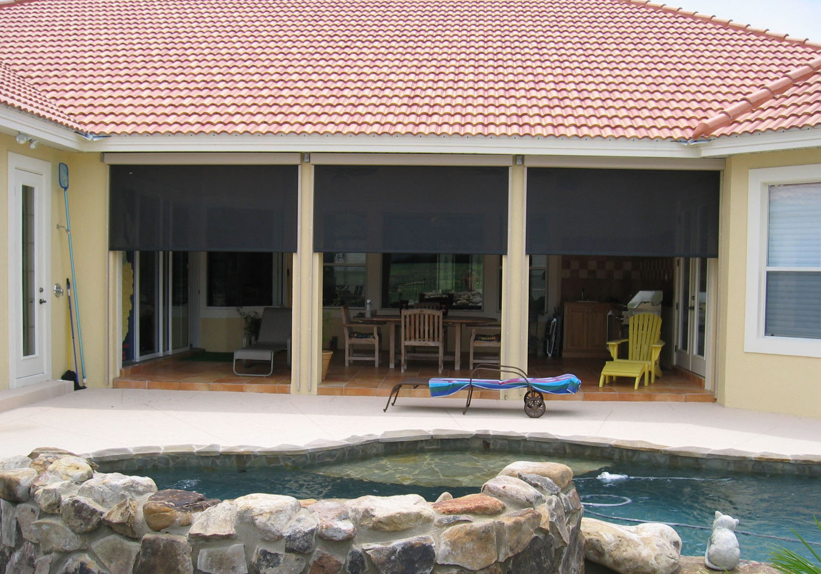 flatiron window fashions offers exterior roll down systems including custom free hanging patio shades at competitive prices solve your patio or window